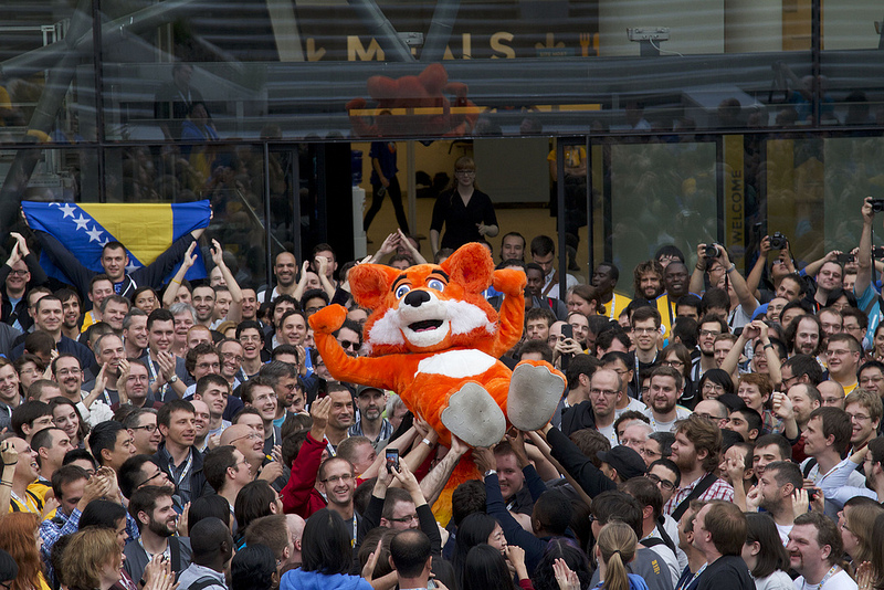 Photo of Firefox crowd surfing at Mozilla Summit 2013